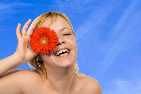 Young  radiant happy woman having fun under a blue sky Stock Photo - 789792