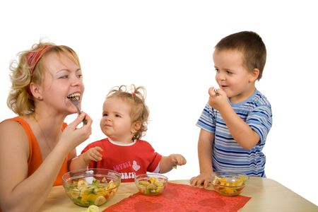 Mother and children eating healthy - fruit salad (isolated)