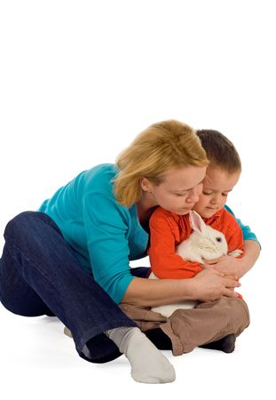 Mother teaching her young child how to hold a bunny (easter theme, isolated) photo