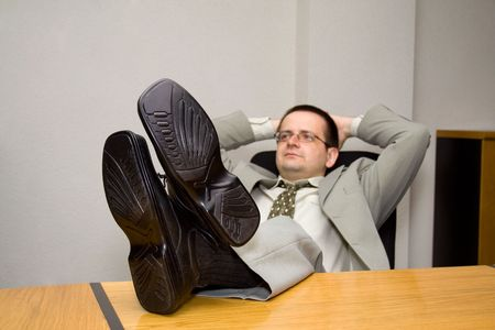Satisfied businessman dreaming up the future - business concept - shallow depth of field - focus on shoes Stock Photo - 893815