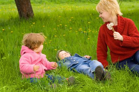 Mother and young children enjoying the spring with seasonal fun activities