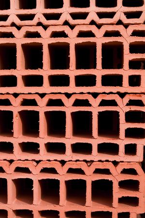 Stacked bright red bricks with holes - for background Stock Photo - 936383