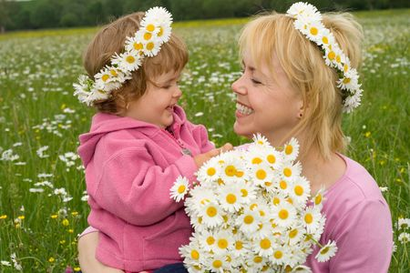 girl picking flowers with her mother in a field full of daisies Stock Photo - 956238
