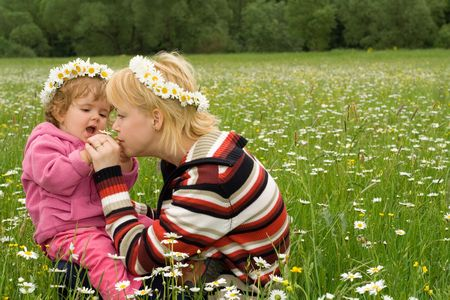 Woman and baby girl having fun on the spring meadow full of daisies Stock Photo - 961711