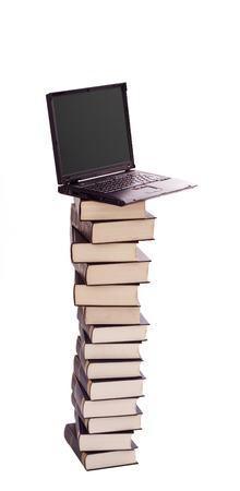 assimilate: Stacked books and laptop - electronic library, learning and knowledge concept - isolated