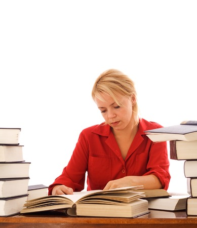 Young woman studying at a desk with lots of large books - isolated Stock Photo - 1683725