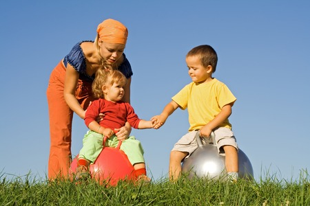 careless: Family in the grass playing together - careless childhood concept Stock Photo