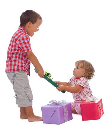 anticipating: Two kids with presents, excited and anticipating great gifts inside - isolated christmas or birthday theme