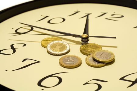 business metaphore: Time and money concept - with euro coins