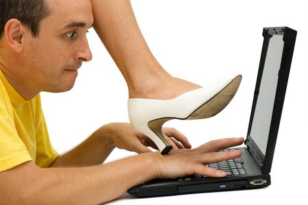 Woman stepping on man's hand, warning him to stop working - isolated Stock Photo - 1933568
