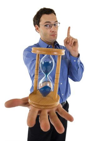 Businessman with hourglass aware of the approaching deadline - isolated - focus on hourglass photo