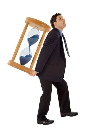 Businessman carrying a hourglass - concept for working under the pressure of a deadline - isolated photo