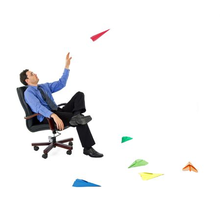 Businessman launching colored paper planes - launching new ventures concept - isolated
