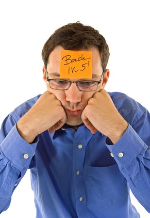 preoccupied: Businessman propping his head, taking a five minutes break - isolated Stock Photo
