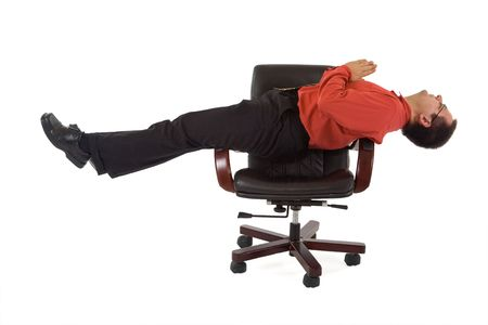 Businessman or office worker relaxing on the office chair - isolated Stock Photo