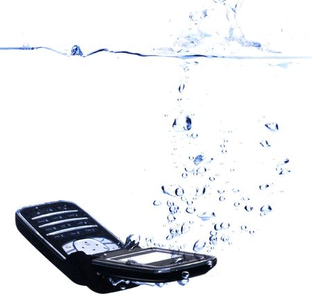 out of water: Phone splashing into water - concept for relaxing, taking time out or communication failure (with copyspace)