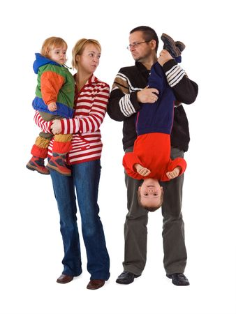 Casual young family with two kids - isolated