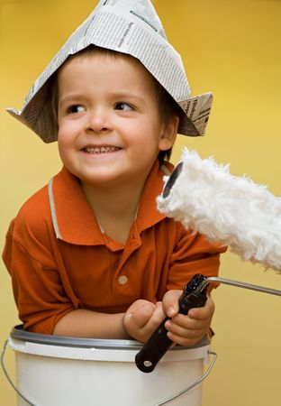 painter: Happy boy with a newspaper helmet, preparing to paint Stock Photo