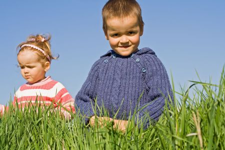 Kids playing in the green grass Stock Photo - 2948927