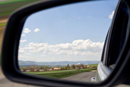 wandering: Springtime wandering with a car on the countryside - rearview mirror