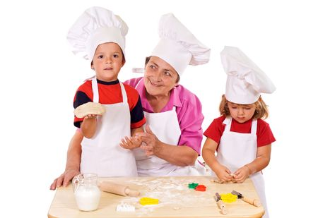 Kids with grandmother preparing cookies - isolated