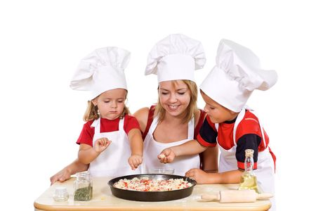 Little boy and girl with their mother preparing a pizza - isolated