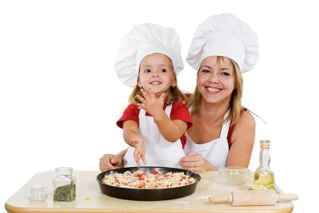 Proud little girl making her first pizza with her mother - isolated