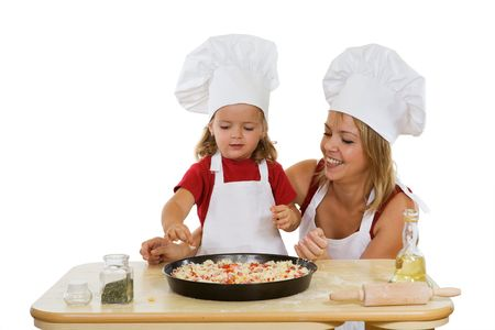 Woman and little girl preparing a pizza - isolated Stock Photo