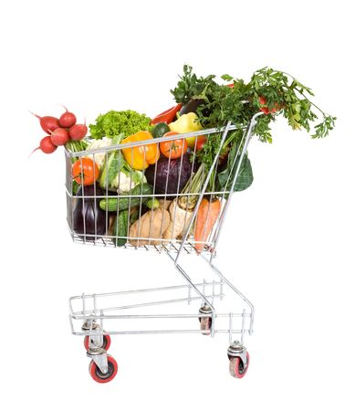 grocery cart: Shopping cart filled with fresh vegetables - isolated
