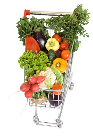 Shopping cart full with vegetables, top view, isolated on white