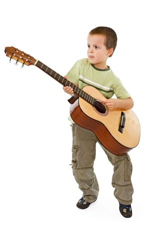 absorbed: Little boy playing acoustic guitar - isolated