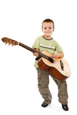 Little smiling boy with acoustic guitar - isolated photo