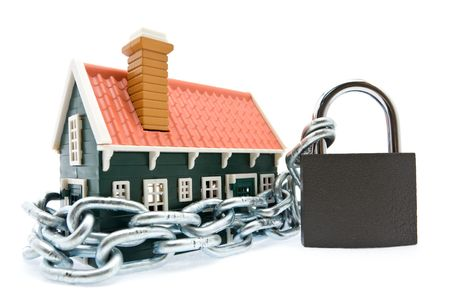 House in chains locked with padlock on white background photo
