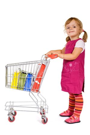 Little girl with shopping with a cart and colorful bags - isolated photo