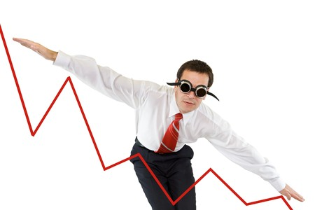 going down: Businessman going down along a chart - isolated Stock Photo