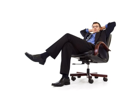 Businessman relaxing in armchair - isolated photo
