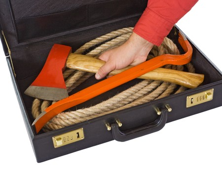 Briefcase with rope, axe and crowbar with a mans hand - isolated