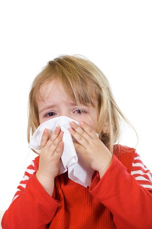 coughing: Little girl with the flu blowing her nose - isolated