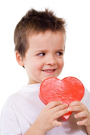 Happy little boy with valentines heart present - isolated Stock Photo - 4174723