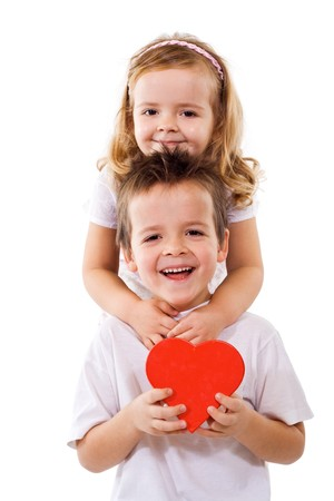 Happy kids hugging and holding a red heart - isolated Stock Photo - 4174720