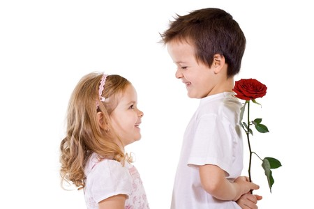 Little boy giving a rose to a girl - isolated