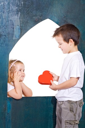 Happy kids playing love - isolated photo