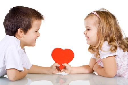 Two happy kids with valentines heart or birthday gift - isolated Stock Photo - 4209719