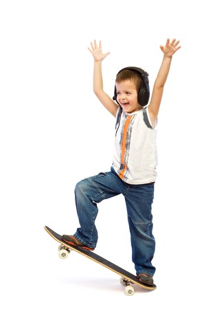 Happy skateboard kid with headphones - isolated Stock Photo - 4297220