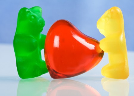 Gummy bear candy with red heart - naive love concept