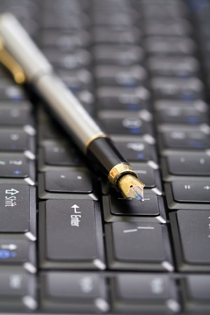 Pen over computer keyboard - shallow depth of field Stock Photo - 4342314