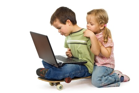 usage: Kids rival over computer usage - isolated Stock Photo