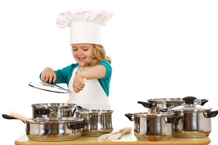 stirring: Happy chef girl stirring soup in a bowl - isolated Stock Photo