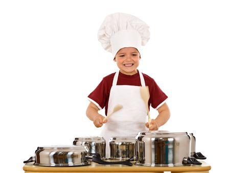 banging: Cooking has a fun beat - ecstatic boy chef banging the cooking pots with wooden spoons, isolated