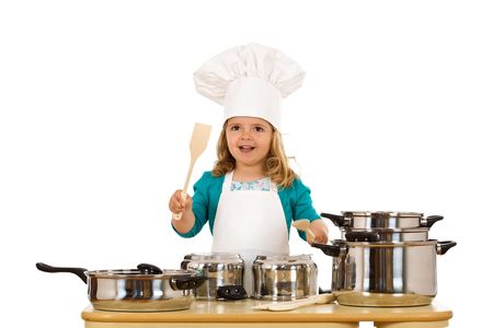 Little girl chef banging the beat on the cooking pots - isolated photo